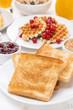 toast, waffles, peanut butter, jam, muesli for breakfast