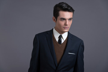 Retro fifties business fashion man with dark grease hair. Wearin