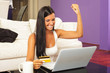 Woman using laptop and shopping online with credit card