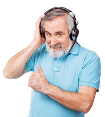 Old guy listening to music with headphones