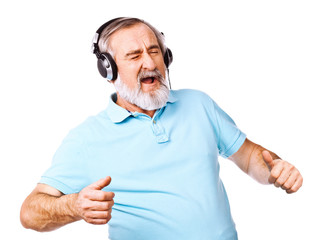 Old guy listening to music on his headphones