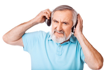 Old guy holding the headphones