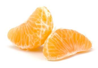 Peeled tangerine segments isolated on white background