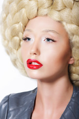 Extravagant Hairstyle. Woman with Creative Art Trendy Wig