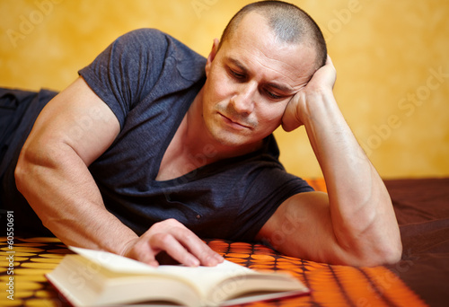 Casual man reading a book