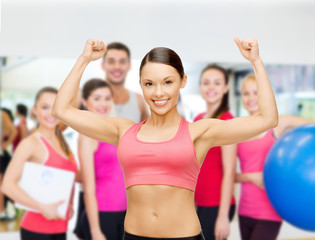 personal trainer with group in gym