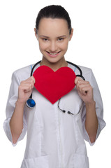 Doctor with stethoscope holding a heart