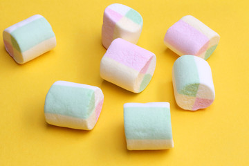 Marshmallows on yellow background