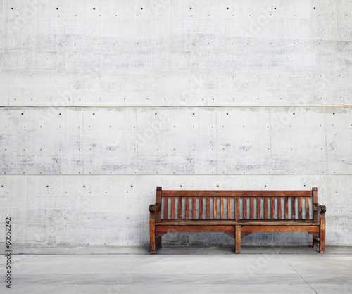 Antique bench on bright concrete background - 60552242