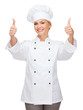 smiling female chef showing thumbs up