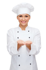 smiling female chef holding something on hands