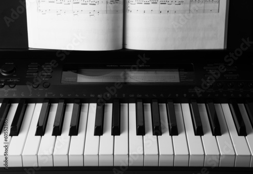 Piano keys and musical book