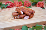 mini sausages on a wooden board