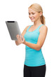sporty woman with tablet pc