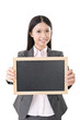 Asian business woman holding blank blackboard