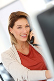Businesswoman in office talking on the phone