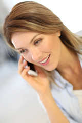 Smiling businesswoman talking on mobile phone