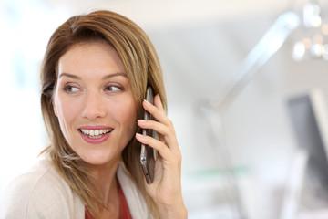 Portrait of confident businesswoman talking on the phone