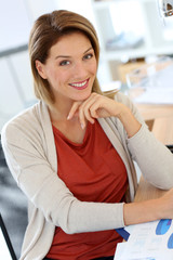 Successful businesswoman sitting at desk in office