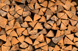 Stack of split logs in a woodpile poster