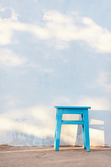 blue rural stool on white wall background