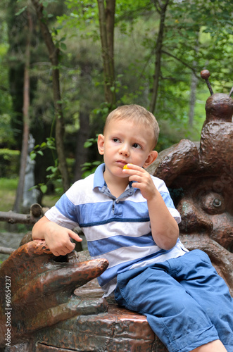 Young boy sitting thinking
