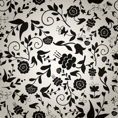 Seamless vintage pattern with black flowers on gray background