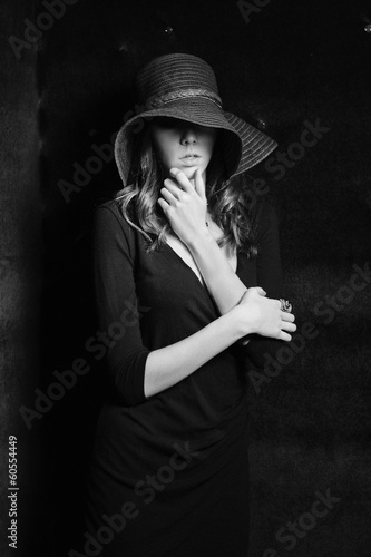Girl in black dress and hat