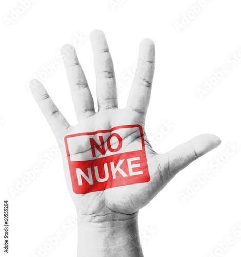 Open hand raised, No Nuke sign painted