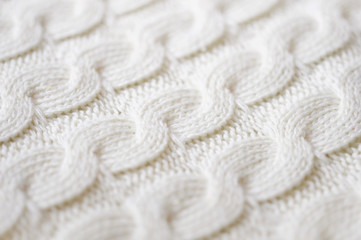 Knitted fabric texture closeup. Small shallow DOF
