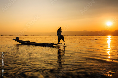 A local fisherman is travelling by boat, Inle lake, Myanmar.
