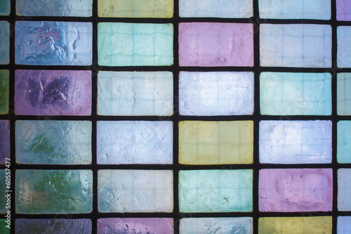 colored glass window with block pattern blue green tone