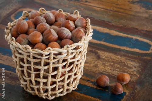 Hazel nuts in wicker busket on table