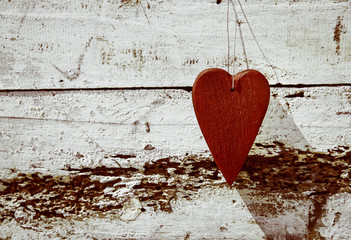 ustic red valentine heart on old weathered wood background.
