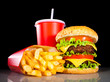 canvas print picture - Tasty hamburger and french fries on a dark