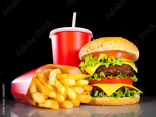 canvas print picture Tasty hamburger and french fries on a dark