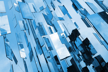 Abstract blue mirrors background above the sky