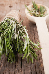 rosemary and leaves in a spoon