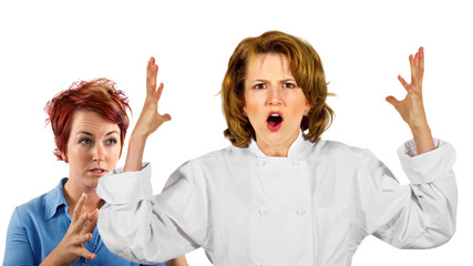 young female chef and waitress co-workers fighting