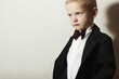 Fashionable Little Boy in Black Suit.Stylish fashion children.