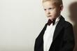 Fashionable Little Boy in Black Suit.Stylish fashion children.