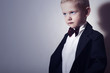 Handsome Little Boy in Black Suit. fashion children.Bow-tie