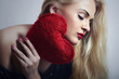 Lovely Beautiful Blond Woman with Red Heart. Beauty Girl