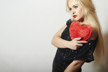 Beautiful Blond Woman with Red Heart. Girl Show Love Symbol