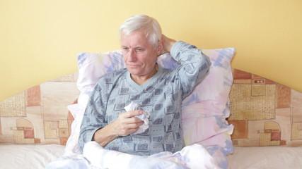 Ill senior man resting in bed.
