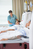 Nurse Looking At Patient Undergoing Renal Dialysis