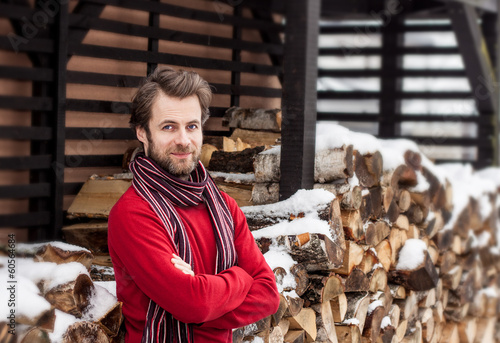 Smiling man standing outdoor - winter countryside landscape