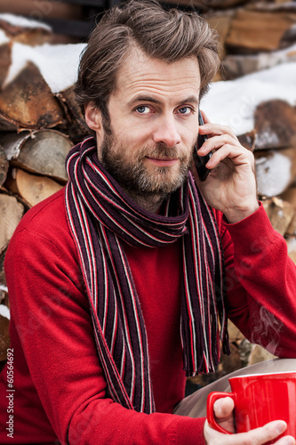 Man talking on a mobile phone outdoor during winter