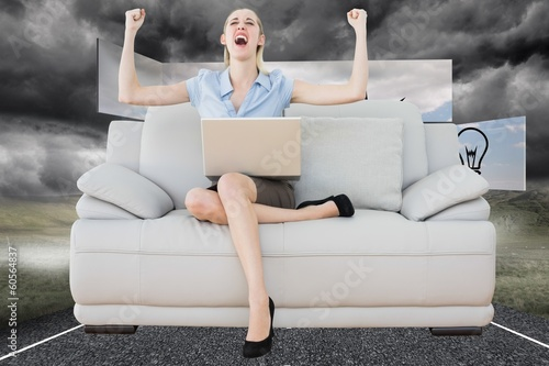 Composite image of cheering beautiful businesswoman sitting on c