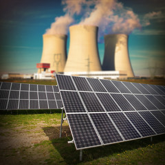 Solar panels against nuclear power plant.